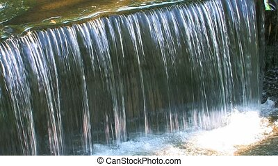 Little waterfalls sparkling in sunlight, closeup, Canon XH...