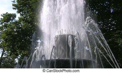 Fountain waterdrops in sunlight