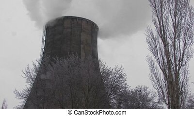 Coal burning power station with trees on foreground, Canon...
