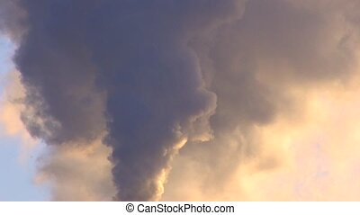 Exhaust smoke on blue sky background at sunset, Canon XH A1,...