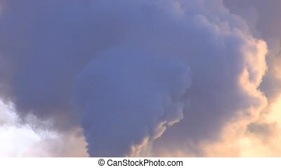 Exhaust smoke on blue sky background at sunset, closeup,...