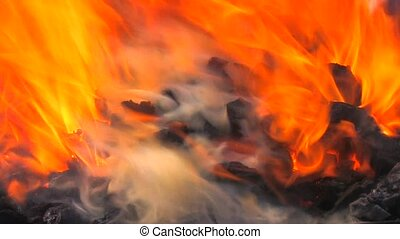 Sparks and flames from charcoal fire in blacksmith, closeup,...