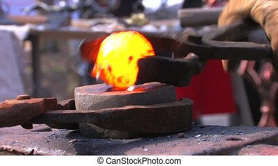 Blacksmith demonstration in Blacksmith Shop, closeup, Canon...