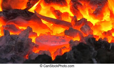 Iron in the forge like inferno, closeup, Canon XH A1, 1080p,...