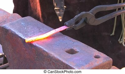 Glowing iron ready for blacksmith