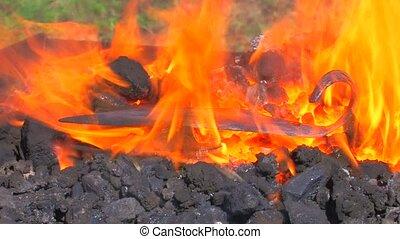 Super hot coals are heating metal