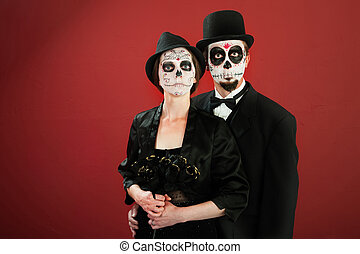 Dia De Los Muertos - Classic vintage woman poses with black...