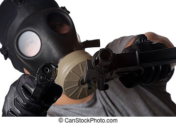 Terrorist Man Pointing Guns - A man wearing a gas mask...