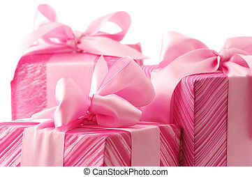 Pink gifts close-up - Three pink gifts with satin bows...