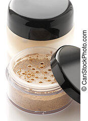 Cosmetic products close-up - Make-up: jars of loose powder...
