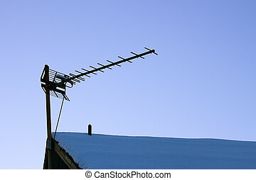 Television antenna over the snowy roof - The television...