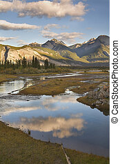 Reflections of clouds - The silent river surrounded by...