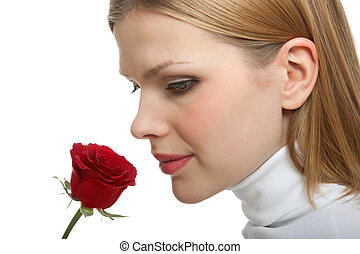 young beautiful woman with a single red rose - young...