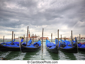 Gondloas at Saint Mrk's Square, San Marco Piazza Venice Italy under stormy sky