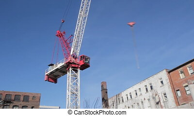 Red crane rotates timelapse Wide - Red tower crane at...