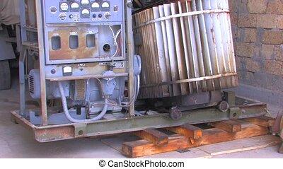 Broken-down equipment in workshop - Broken-down generator in...