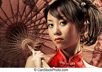 Asian portrait - Portrait of a Chinese beauty holding a...