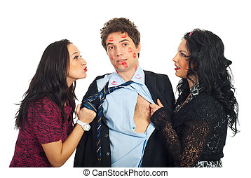 Man kissed by two elegant women - Two women pulling the...