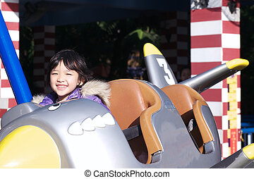 kid playing in the amusement park