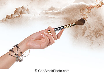 powder - Close up view of woman%u2019s hand holding brush on...