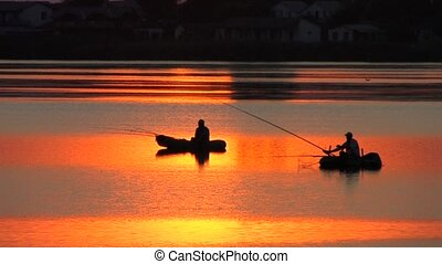 Fishing boats at sunset - Fishing boats on the lake at...