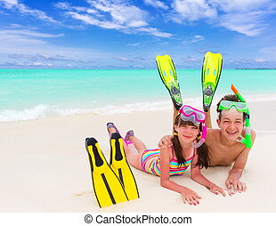 Children on beach with snorkel - Happy young brother and...