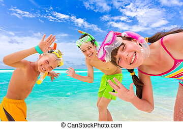 Happy children on beach - Three happy children with snorkels...