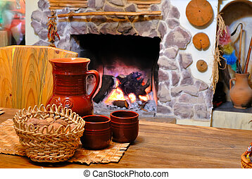 comfort of home hearth with a jug of wine