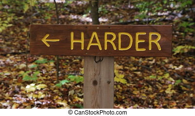 Easier and Harder signs. Two shots. - Signs showing the...