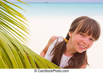 Happy girl on tropical beach - Happy young girl looking...