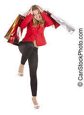 shopping madness - woman holding shopping bags holding head...