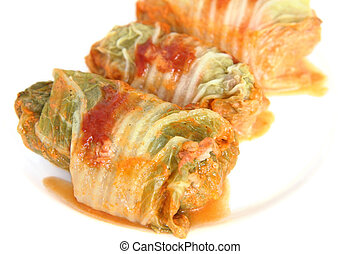 Three stuffed cabbage with tomato s - Three stuffed cabbage...