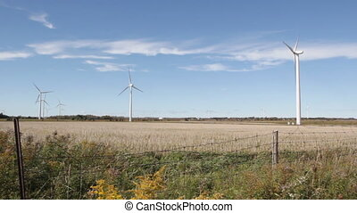 Windfarm. Farmer's fields. - Fence, field and windfarm....