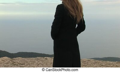 Young lady on a mountain top - Beautiful young lady sending...