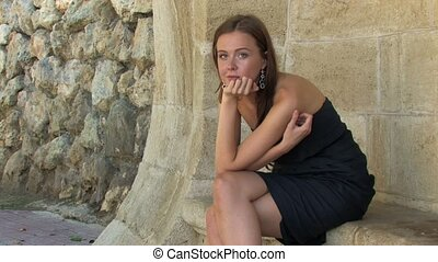 Pretty young lady - Beautiful young long-haired lady sitting...