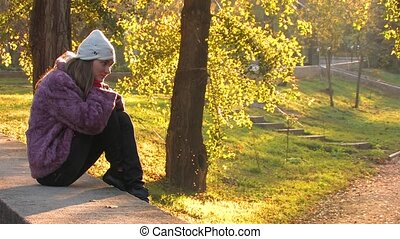 Autumn solitude in Park - Pretty young Woman in Park on...
