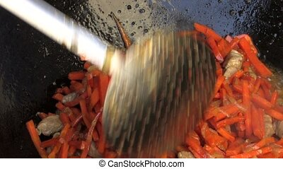 Stirring grated carrots - Stirring Pilaf ingredients in Wok,...