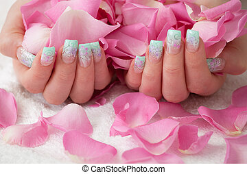 Beautiful hands - Holding pink rose petals. Artificial...