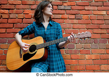 Young Brunette Female  Playing Guitar