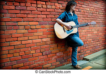 Brunette Female  Playing Guitar