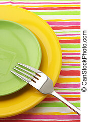 Multicolored plates and fork
