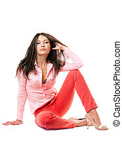 Sexy young woman in red jeans. Isolated on white