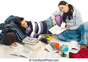 Tired students of studying - Three student fall asleep on...