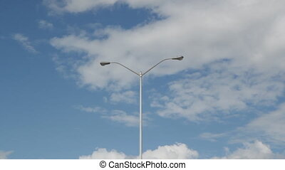 Passing streetlights - Low angle view from car of...