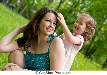 Mother enjoying free time with her child - Cute girl is...