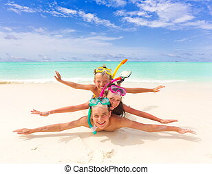 Children playing on beach - Three happy children with...