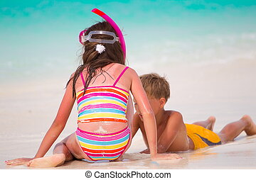Children playing on beach - Young boy and girl with snorkel...