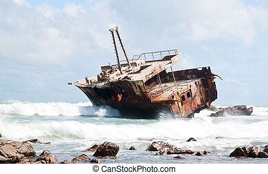 Aghullas shipwreck lying on the rocks in the breakers