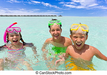 Happy children in sea