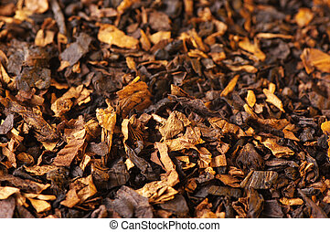Tobacco as background - Cut dried leaves of tobacco as...
